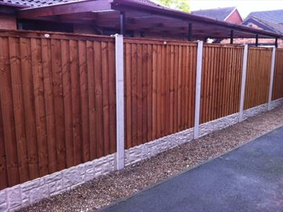 Premium Feather Edge Panels in Situ with Concrete Posts and Gravel Boards - Front