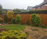 6 x 6 pressure treated premium feather edged fence panels with wooden posts and caps fitted in Toton.