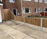 A fence finished off nicely with a sloping panel and matchboard gate.