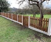 A nice run of picket fencing with a mortice and tenon picket gate to match.