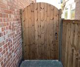 Arched matchboard gate with key lock fitted in Sawley.
