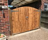 Arched matchboard gates and posts fitted in Trowell.