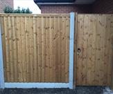 Fencing and matchboard gate with key lock fitted in Sawley.