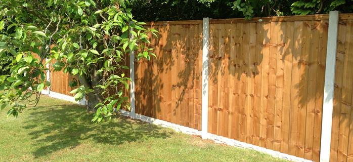 Premium Feather Edge Fence Panels with Concrete Rock Faced Gravel Boards and Concrete