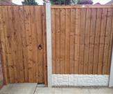 Premium Feather Edge Panel with Conrete Posts and Gravel Boards and Matchboard Gate