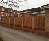 Premium feather edge fence panels fitted inbetween brick pillars. 08.01.19