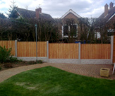 Convexed Feather Edged Fence Panels with Rock Faced Gravel Boards
